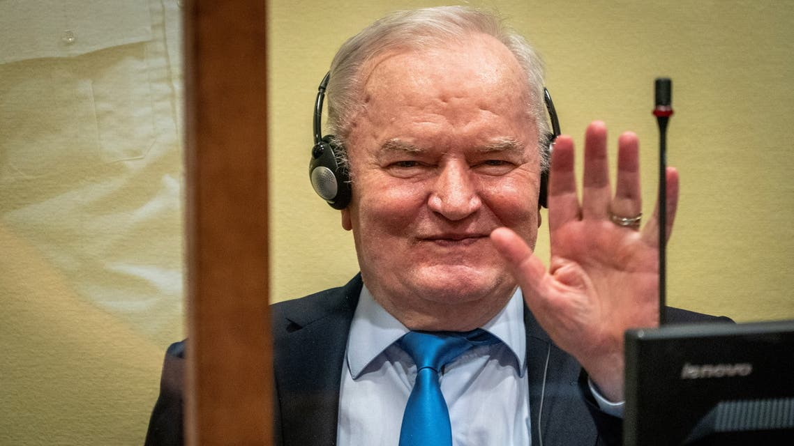 Former Bosnian Serb military leader Ratko Mladic waves in the courtroom prior to the pronouncement of his appeal judgement at the UN International Residual Mechanism for Criminal Tribunals (IRMCT) in The Hague, Netherlands June 8, 2021. Jerry Lampen/Pool via REUTERS