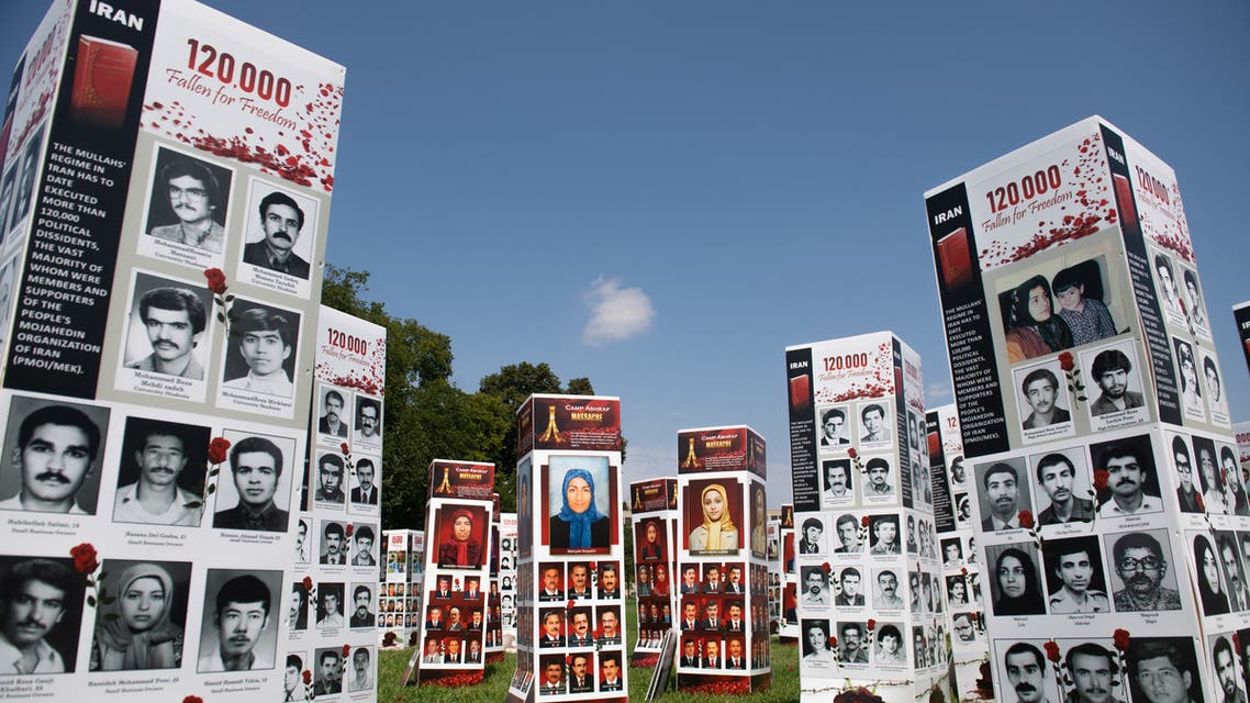 Thousands of photos of people killed in Iran during the 1988 massacre of political prisoners as well as during more recent anti-regime uprisings, during a photo exhibit by the Organization of the Iranian American Communities to highlight human rights violations by the country, near the US Capitol in Washington, DC, September 4, 2020. (File photo: AFP)