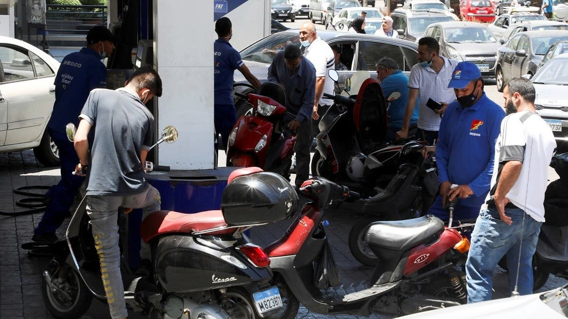 A worker fills up a motorbike with fuel at a gas station in Beirut, Lebanon June 3, 2021. (Reuters)