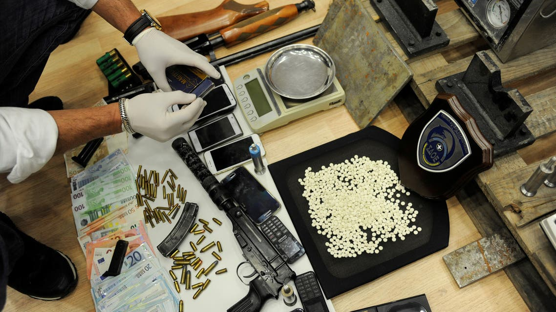 Greek authorities present confiscated guns, money and Captagon amphetamine pills after dismantling a criminal ring near Elefsina, southwest of Athens, Greece, March 6, 2017. (Reuters)