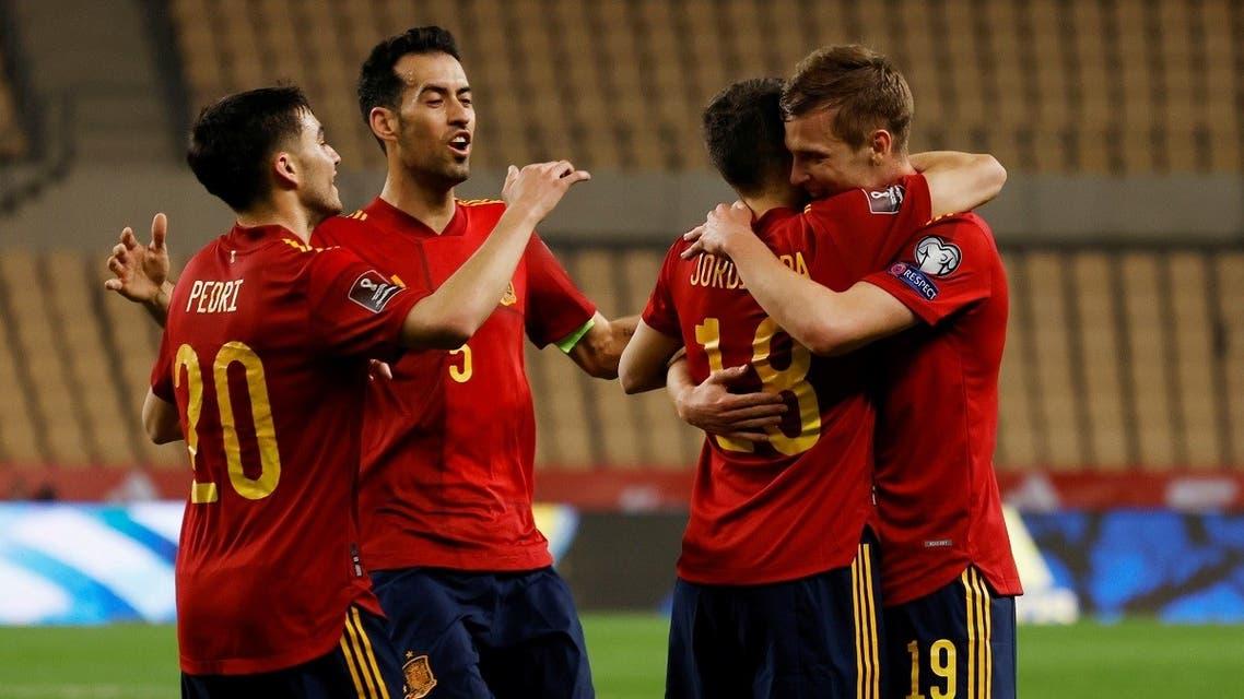 Spain's Dani Olmo celebrates scoring their first goal with Jordi Alba, Pedri and Sergio Busquets. (Reuters)