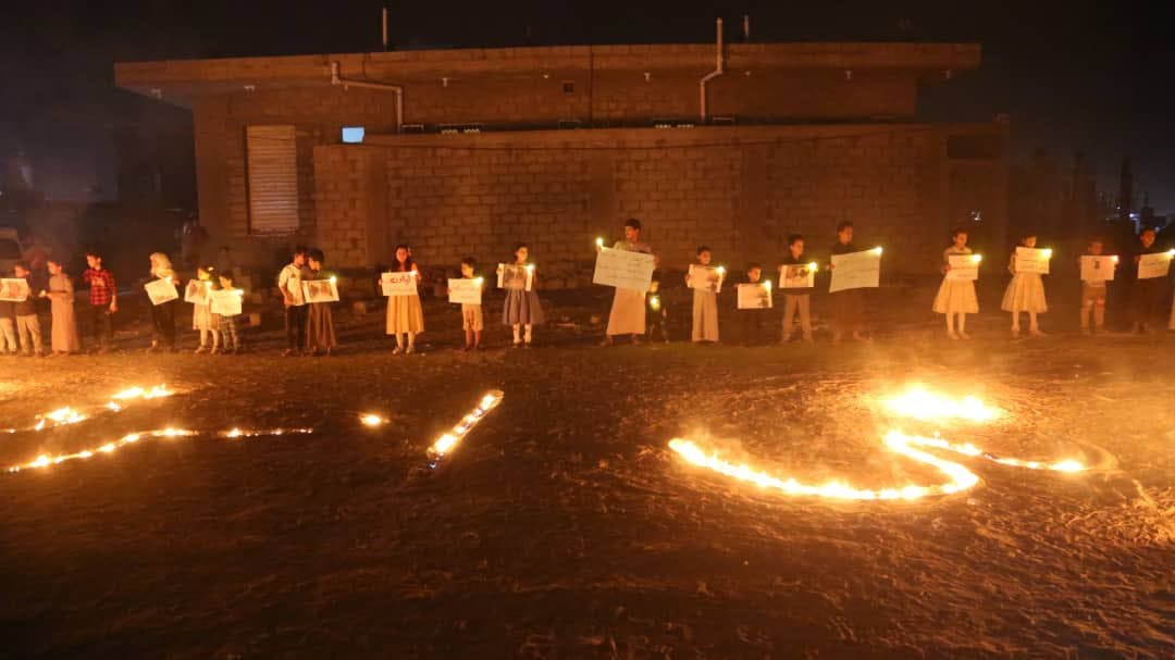 Pictures .. A candlelight stand for die Children of Ma'rib outside the house of Layan, the victim of the Houthi fuel massacre