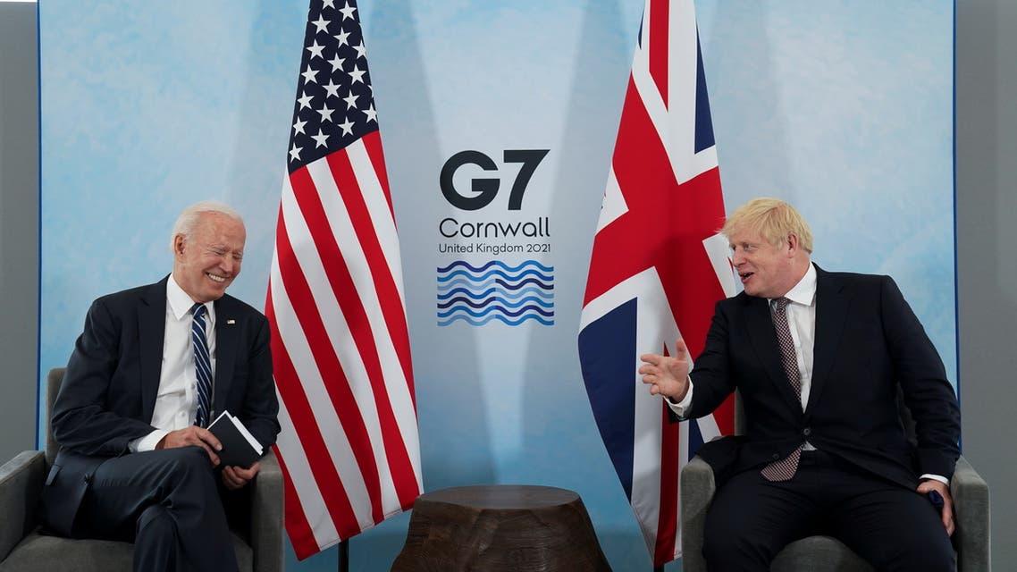 Britain's Prime Minister Boris Johnson speaks with U.S. President Joe Biden during their meeting, ahead of the G7 summit, at Carbis Bay, Cornwall, Britain June 10, 2021. (Reuters)