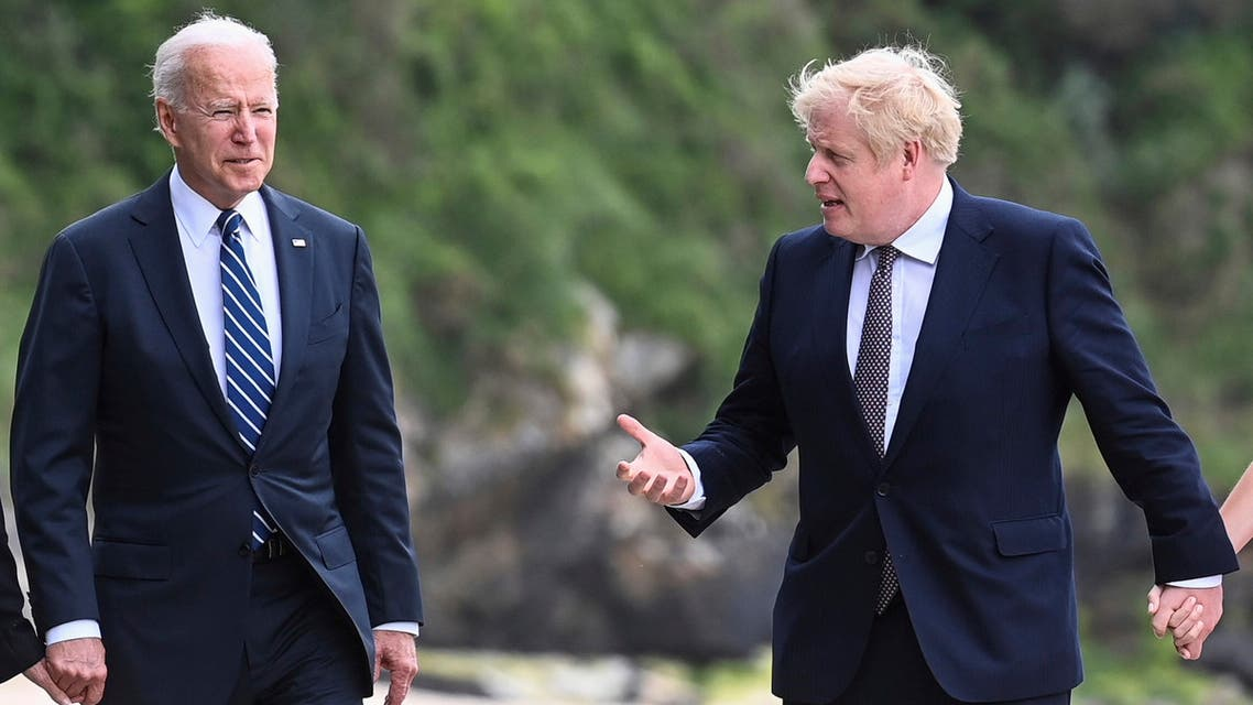 US President Joe Biden, left, talks with Prime Minister Boris Johnson, during a walk, with their wives (not pirctured) outside Carbis Bay Hotel, Carbis Bay, Cornwall, Britain, ahead of the G7 summit, Thursday June 10, 2021. (AP)