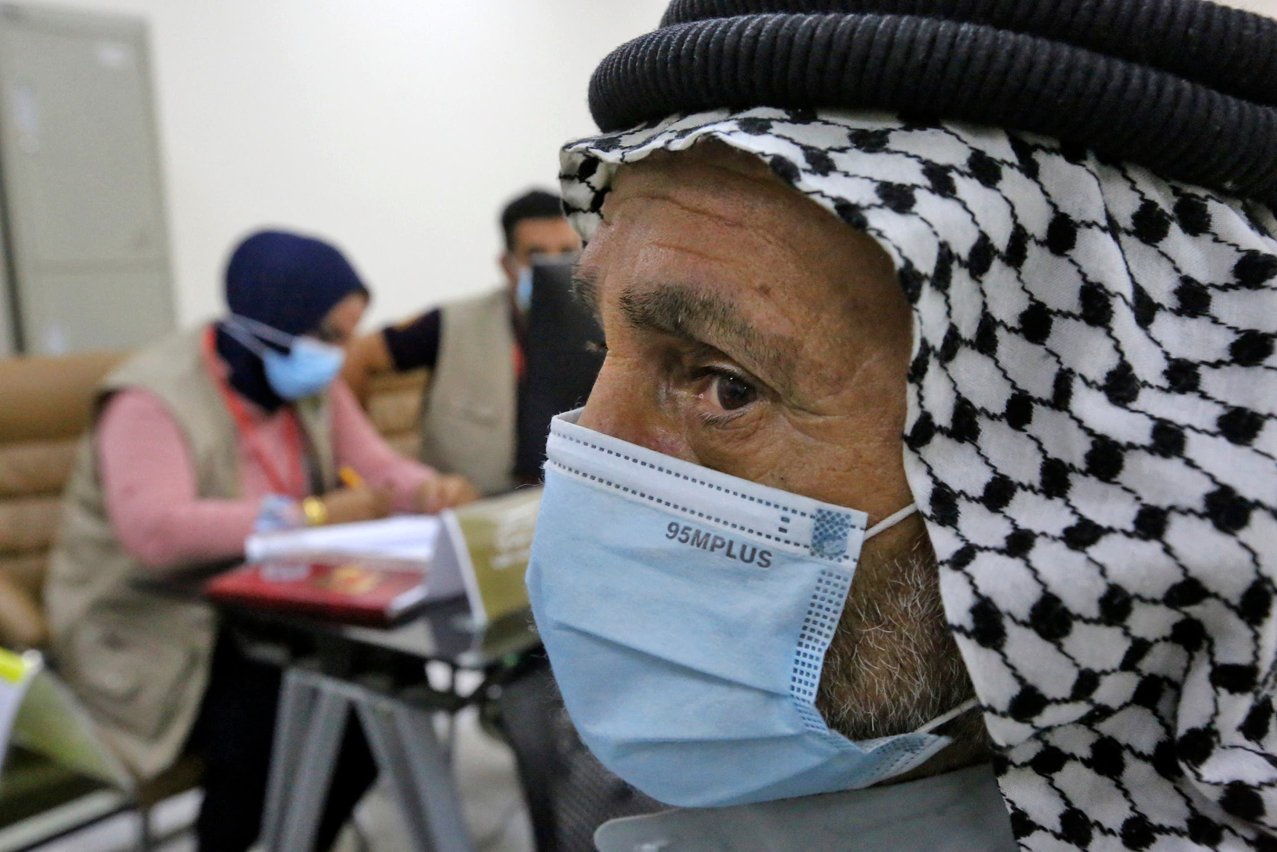 families of Iraqis whose bodies were found in mass graves in the village of Badush, northwest of the city of Mosul, when it was in the hands of the Islamic State group, wait to give blood to Iraqi forensic experts to match with the remains of their loved ones for identification, on June 9, 2021 in Baghdad. (AFP)