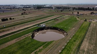 Mexico farm sinkhole swallows more land, eats at house as it expands