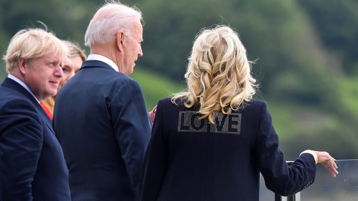 """US first lady Jill Biden wearing a jacket with the word """"Love"""" stands next to US President Joe Biden, Britain's Prime Minister Boris Johnson and his wife Carrie Johnson, during their meeting, at Carbis Bay, Cornwall, Britain, on June 10, 2021. (Reuters)"""