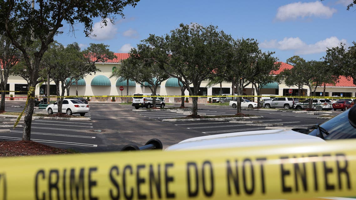 Palm Beach County Sheriff's crime scene tape is seen outside of a Publix supermarket where a woman, child and a man were found shot to death on June 10, 2021 in Royal Palm Beach, Florida. (File photo: AFP)