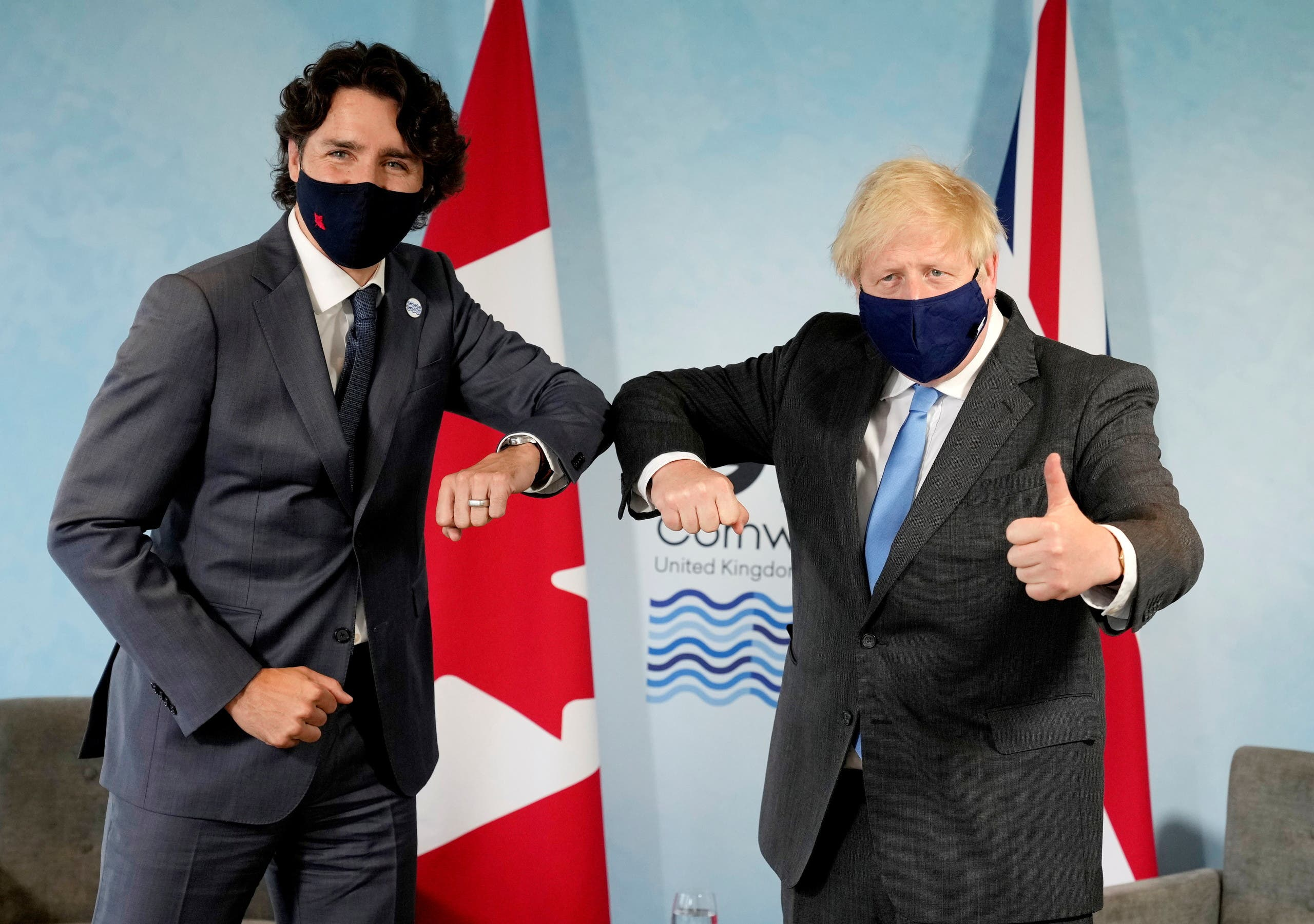 Britain's Prime Minister Boris Johnson and Canada's Prime Minister Justin Trudeau elbow bump prior to a bilateral meeting during the G7 summit in Carbis Bay, Cornwall, Britain, June 11, 2021. (Reuters)