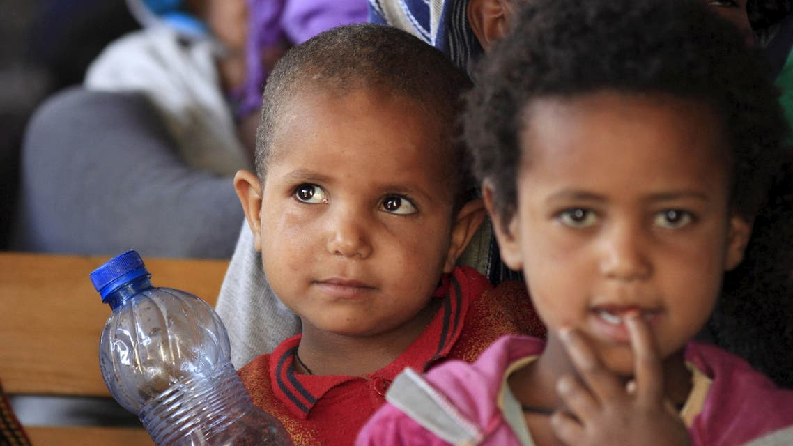 Eritrean refugee children wait to get registered on arrival at Indabaguna refugee reception and screening center in Tigrai region near the Eritrean border in Ethiopia, February 9, 2016. (Reuters)