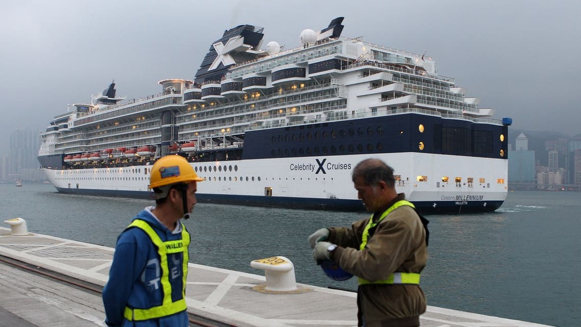 In this file photo taken on March 15, 2013 workers prepare for the arrival of the 'Celebrity Millennium' ship, a Maltese registerd vessel at the under-construction Kai Tak Cruise Terminal in Hong Kong. (File photo: AFP)