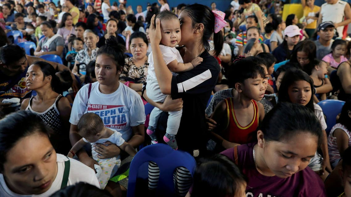 Mothers hold their children while waiting in line to receive free polio vaccine during a government-led mass vaccination program in Quezon City, Metro Manila, Philippines, October 14, 2019. (Reuters)