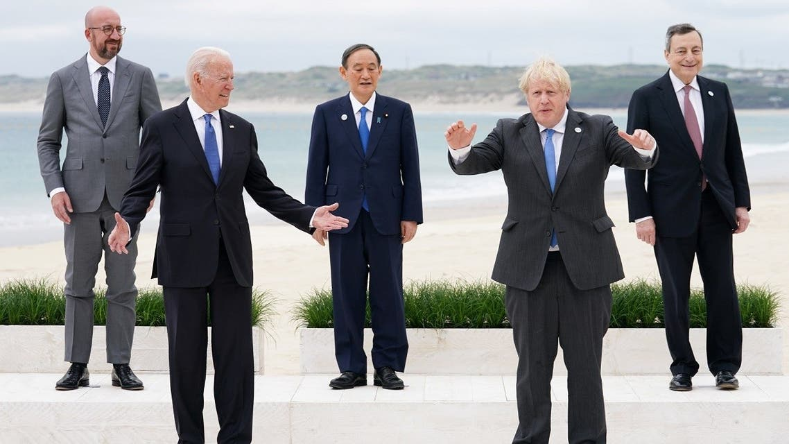 US President Joe Biden, Britain's Prime Minister Boris Johnson, European Council President Charles Michel, Japan's Prime Minister Yoshihide Suga and Italy's Prime Minister Mario Draghi stand for a family photo during the G7 summit in Carbis Bay, Cornwall, Britain, on June 11, 2021. (Reuters)