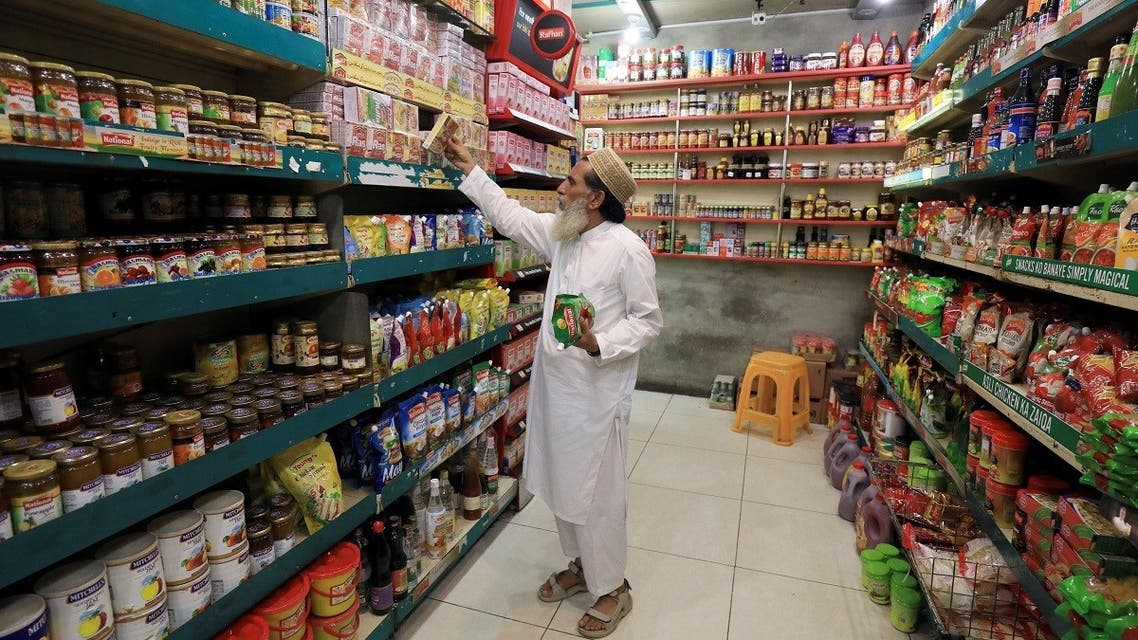 A man shops for grocery items in Peshawar, Pakistan, on June 11, 2021. (Reuters)