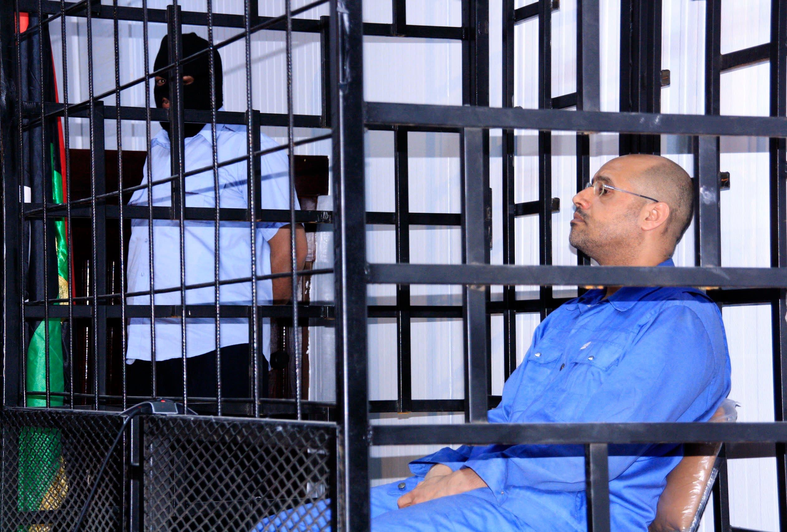 خلال محاكمته في الزنتان عام 2014 (رويترز)