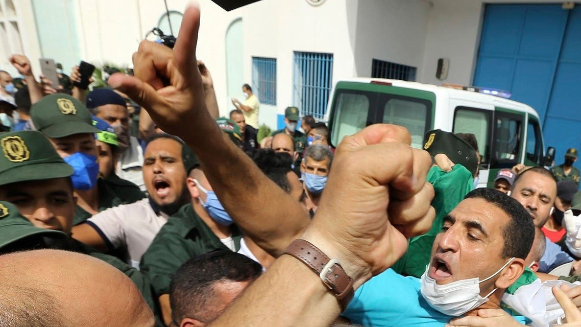 Activist Karim Tabbou flashes a victory sign as he is greeted by supporters as he is released from the prison of Kolea, west of Algiers, Algeria, on July 2, 2020. (AP)