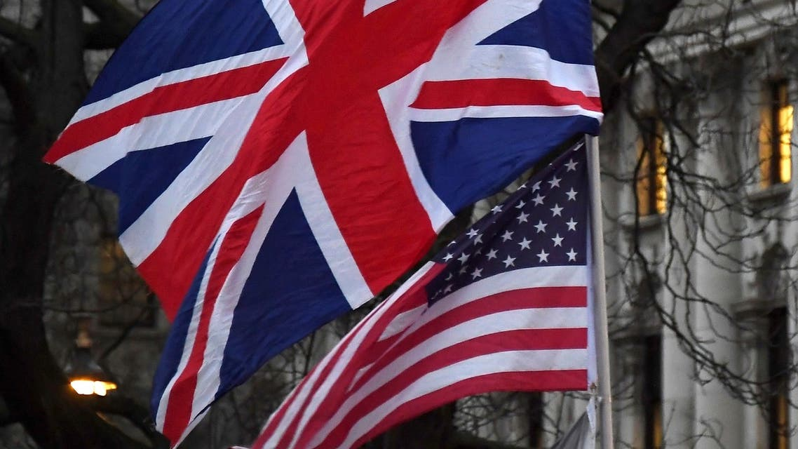In this file photo dated Friday, Jan. 31, 2020, Brexit supporters hold British and US flags during a rally in London. (AP)