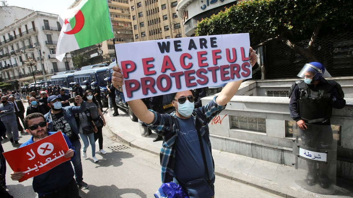 Demonstrators march with banners and flags during a protest demanding political change, in Algiers, Algeria April 9, 2021. (File Photo: Reuters)