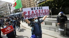 Algeria holds parliamentary elections in 'attrition' battle with protestors
