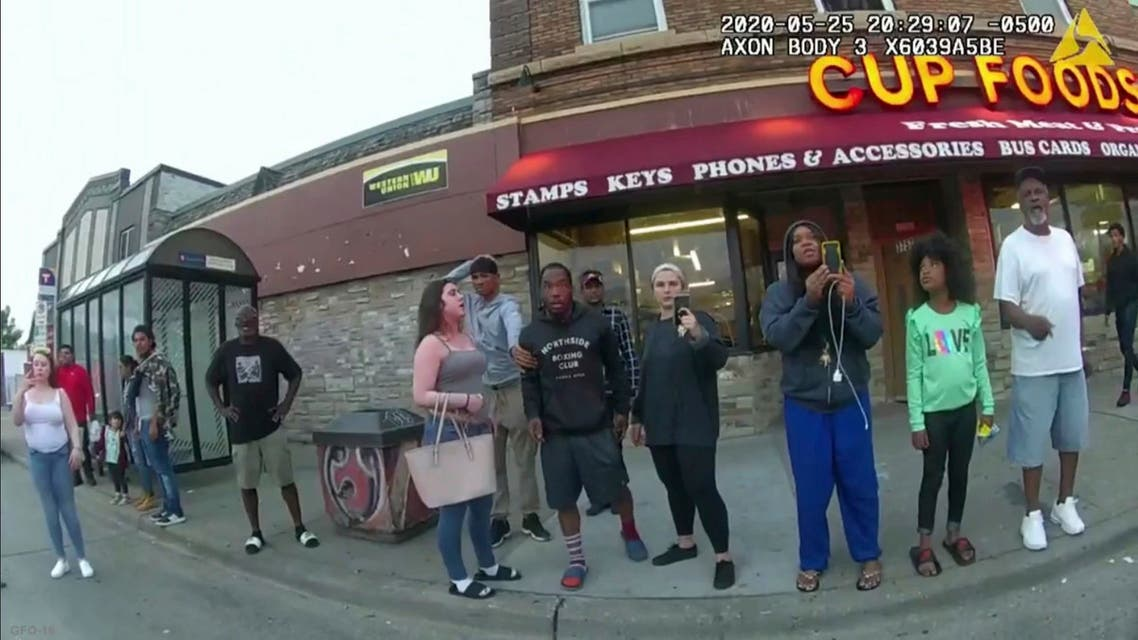This May 25, 2020, file image from a police body camera shows bystanders including Darnella Frazier, third from right filming, as former Minneapolis police officer Derek Chauvin was recorded pressing his knee on George Floyd's neck for several minutes in Minneapolis. Frazier, the teenager who pulled out her cellphone and recorded the police restraint and death of Floyd has been awarded a special citation by the Pulitzer Prizes. (AP)