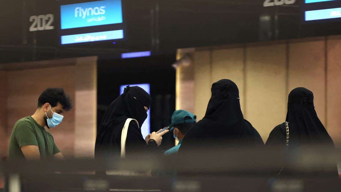 Saudi passengers arrive to King Khaled International airport in the capital Riyadh on May 17, 2021, as Saudi authorities lift travel restrictions for citizens immunized against COVID-19. (AFP)
