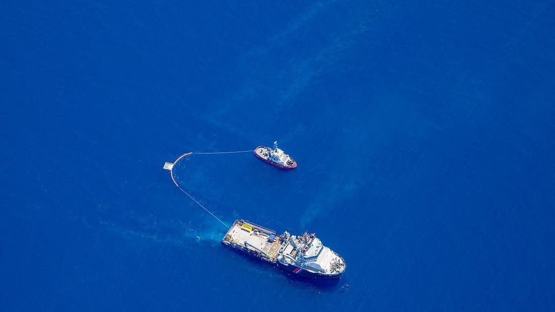 This handout picture shows two boats trying to contain an oil spill approaching eastern Corsica which appears to have leaked from a ship. (Florian Roussard/French Air Force/AFP)