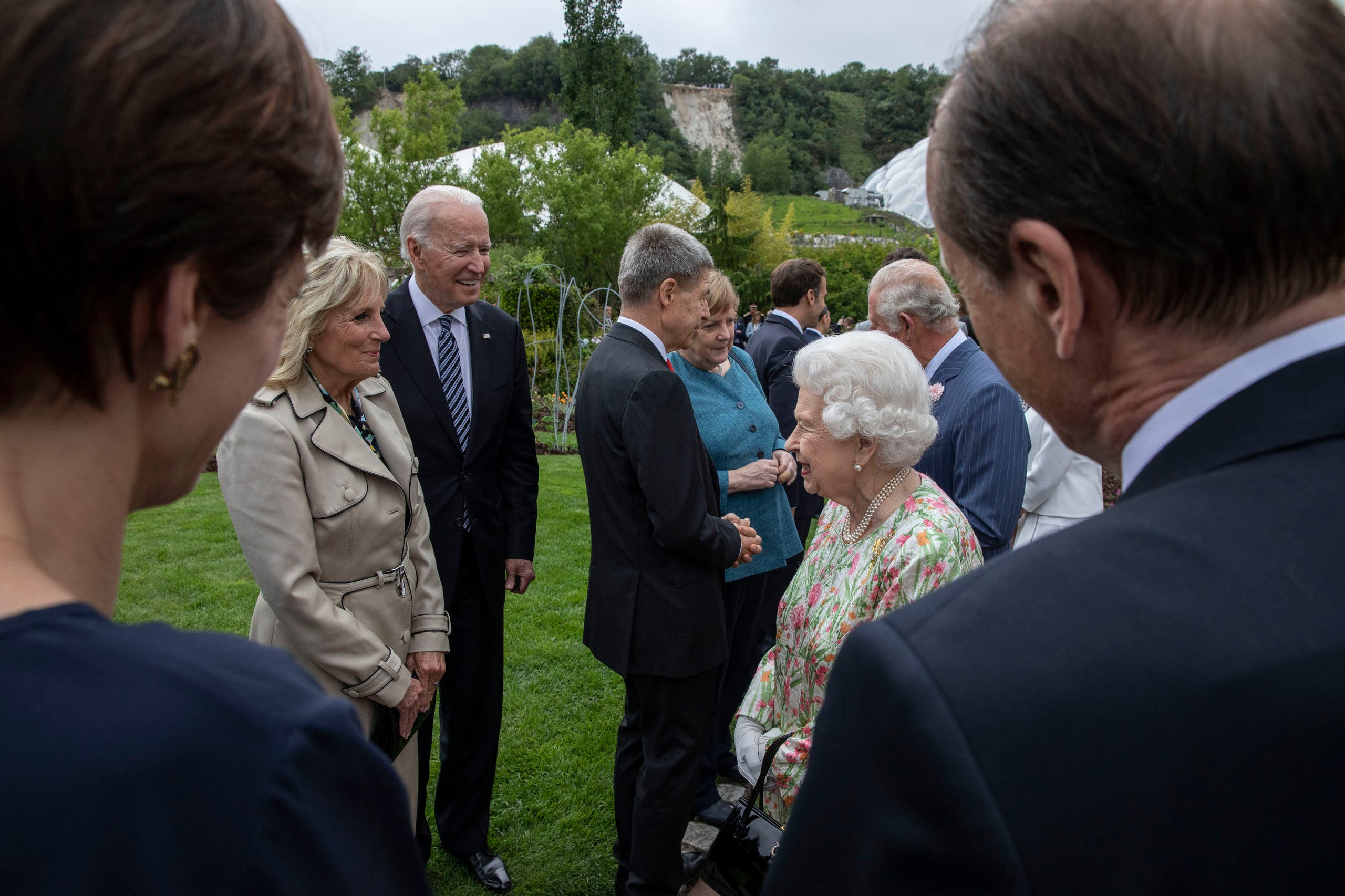 Britain's Queen Elizabeth II, centre. right, speaks to US President Joe Biden, centre left and first lady Jill Biden, at a reception for the G7 leaders at the Eden Project in Cornwall, England, Friday June 11, 2021, during the G7 summit. (AP)