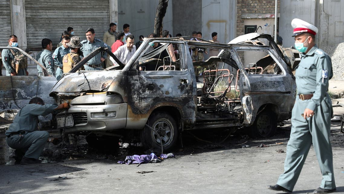 Afghan security forces inspect the wreckage of a passenger van after a blast in Kabul, Afghanistan June 12, 2021. (Reuters)