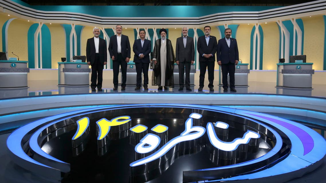 Iran's presidential candidates stand after the election debate at a television studio, in Tehran, Iran June 12, 2021. (Reuters)