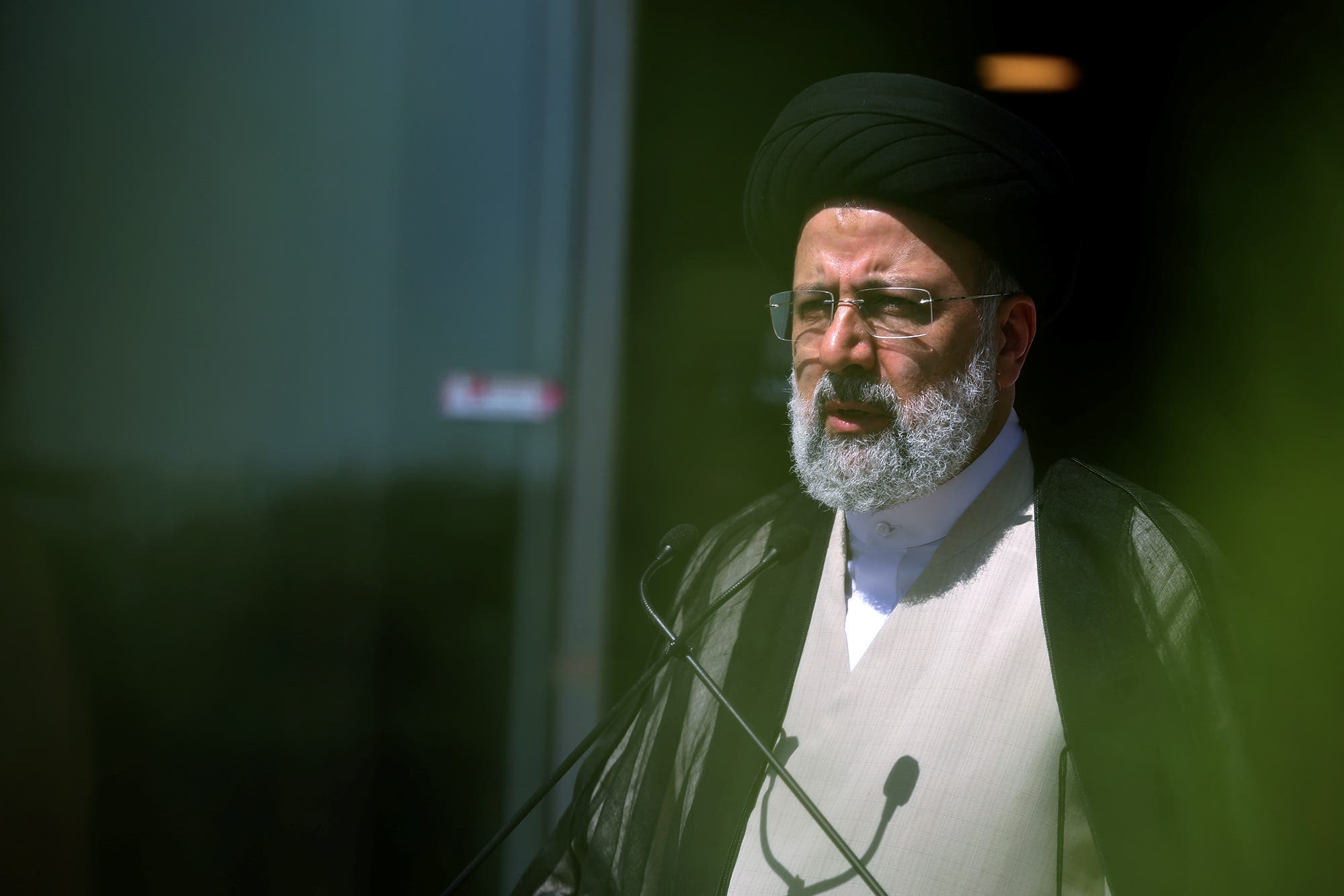 Presidential candidate Ebrahim Raisi speaks with journalists before the start of the last election debate, in Tehran, Iran June 12, 2021. (Reuters)