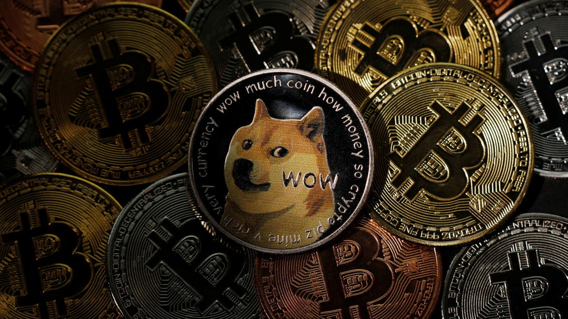 Representations of the Bitcoin and Dogecoin cryptocurrencies are seen in this picture illustration taken June 7, 2021. REUTERS/Edgar Su/Illustration