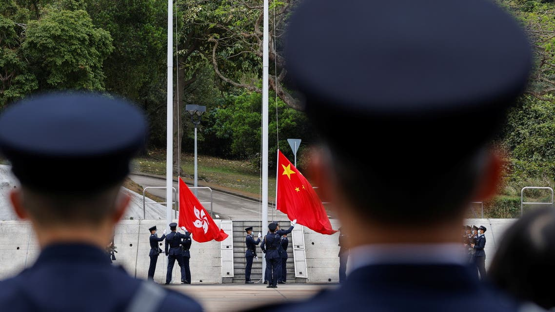 Police raise the Chinese national flag and the Hong Kong flag during an open day to mark National Security Education Day, at Hong Kong Police College, in Hong Kong, China, April 15, 2021. (Reuters)