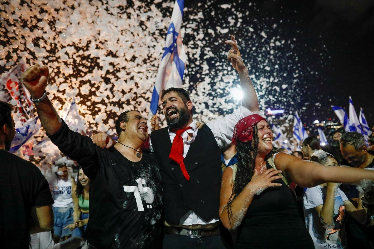 People celebrate after Israel's parliament voted in a new coalition government, ending Benjamin Netanyahu's 12-year hold on power, at Rabin Square in Tel Aviv, Israel. (Reuters)