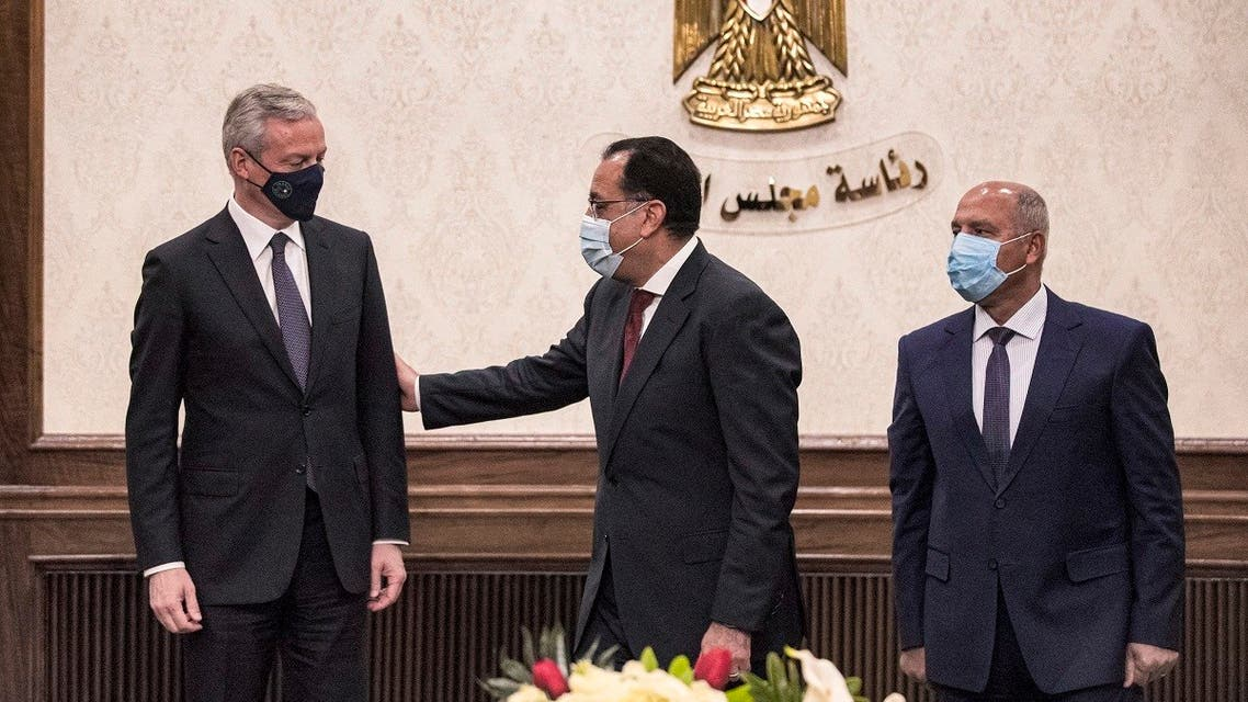 (L to R) France's Economy and Finance Minister Bruno Le Maire, Egypt's PM Mostafa Madbouli, and Egyptian Minister of Transportation Kamel el-Wazir at the prime minister's office in Cairo, Egypt on June 13, 2021. (Khaled Desouki/AFP)