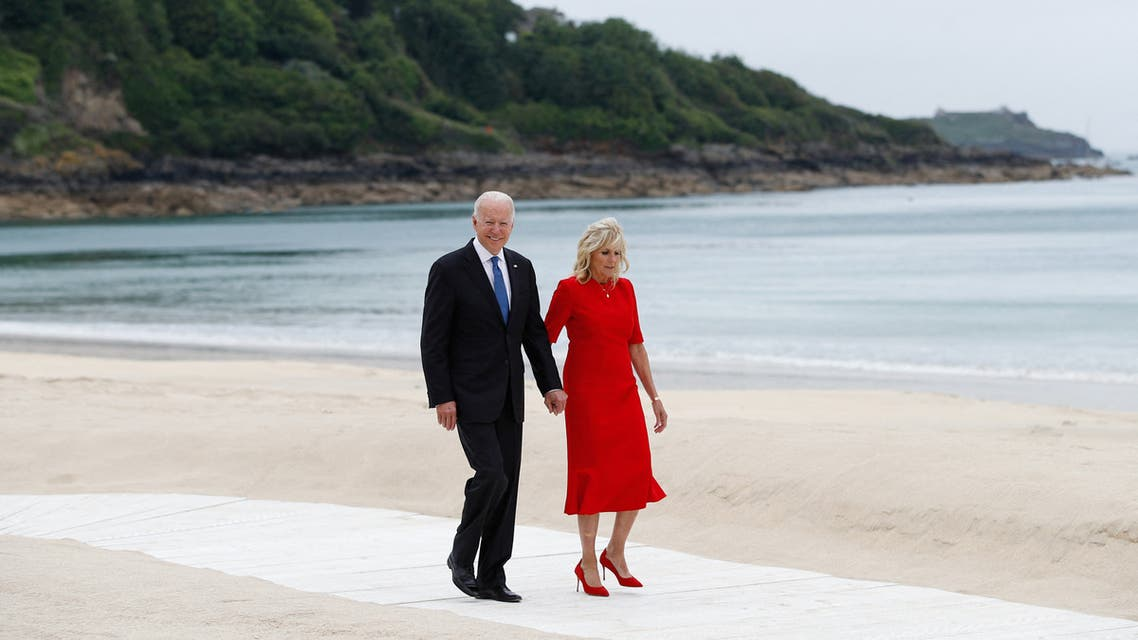 US President Joe Biden (L) and US First Lady Jill Biden walk along the path by the beach during the G7 summit in Carbis Bay, Cornwall, south-west England on June 11, 2021.