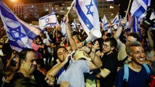 Thousands in Israel's Tel Aviv celebrate end of Netanyahu government