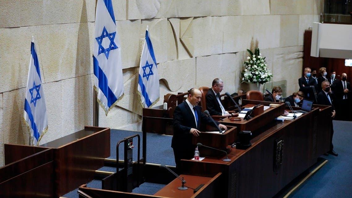 Israel's designated new prime minister Naftali Bennett speaks during a Knesset session in Jerusalem Sunday, June 13, 2021. (AP)