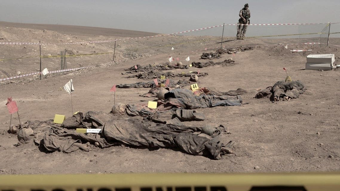 Human remains, reportedly of victims of the 2014 Badush prison massacre committed by ISIS are pictured on June 13, 2021, after being unearthed northwest of the city of Mosul. (Zaid Al-Obeidi/AFP)