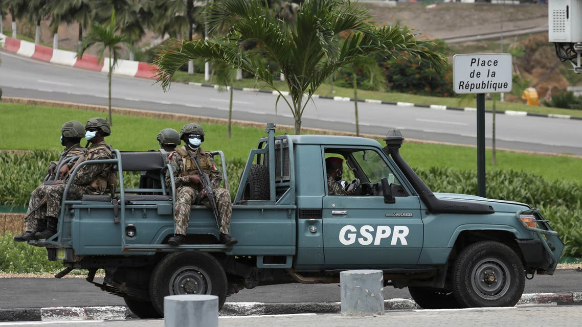 Soldiers ride a vehicle during the national tributes for Ivory Coast's late Prime Minister Amadou Gon Coulibaly at the presidential palace in Abidjan, Ivory Coast July 14, 2020. (Reuters)