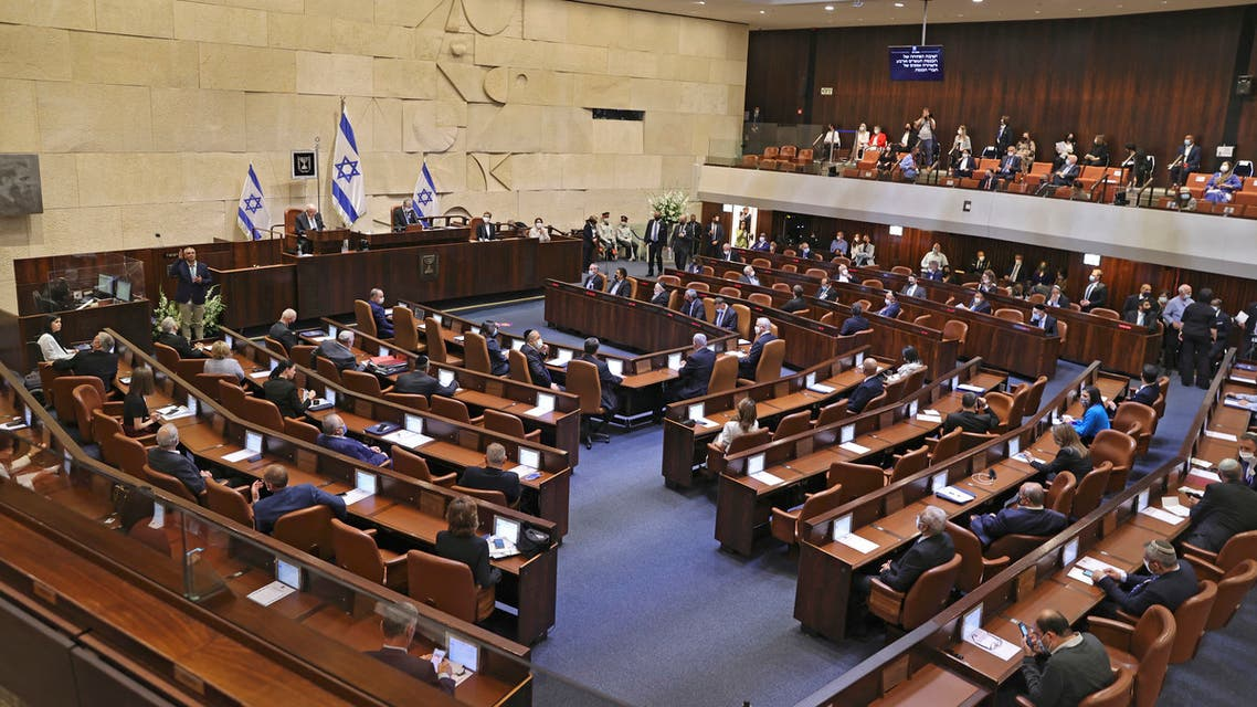 A general view shows the swearing-in ceremony of Israel's Knesset (parliament) in Jerusalem, on April 6, 2021. Israel's president nominated Prime Minister Benjamin Netanyahu to try to form a government, two weeks after the latest inconclusive election, but voiced doubt that any lawmaker could forge a parliamentary majority.