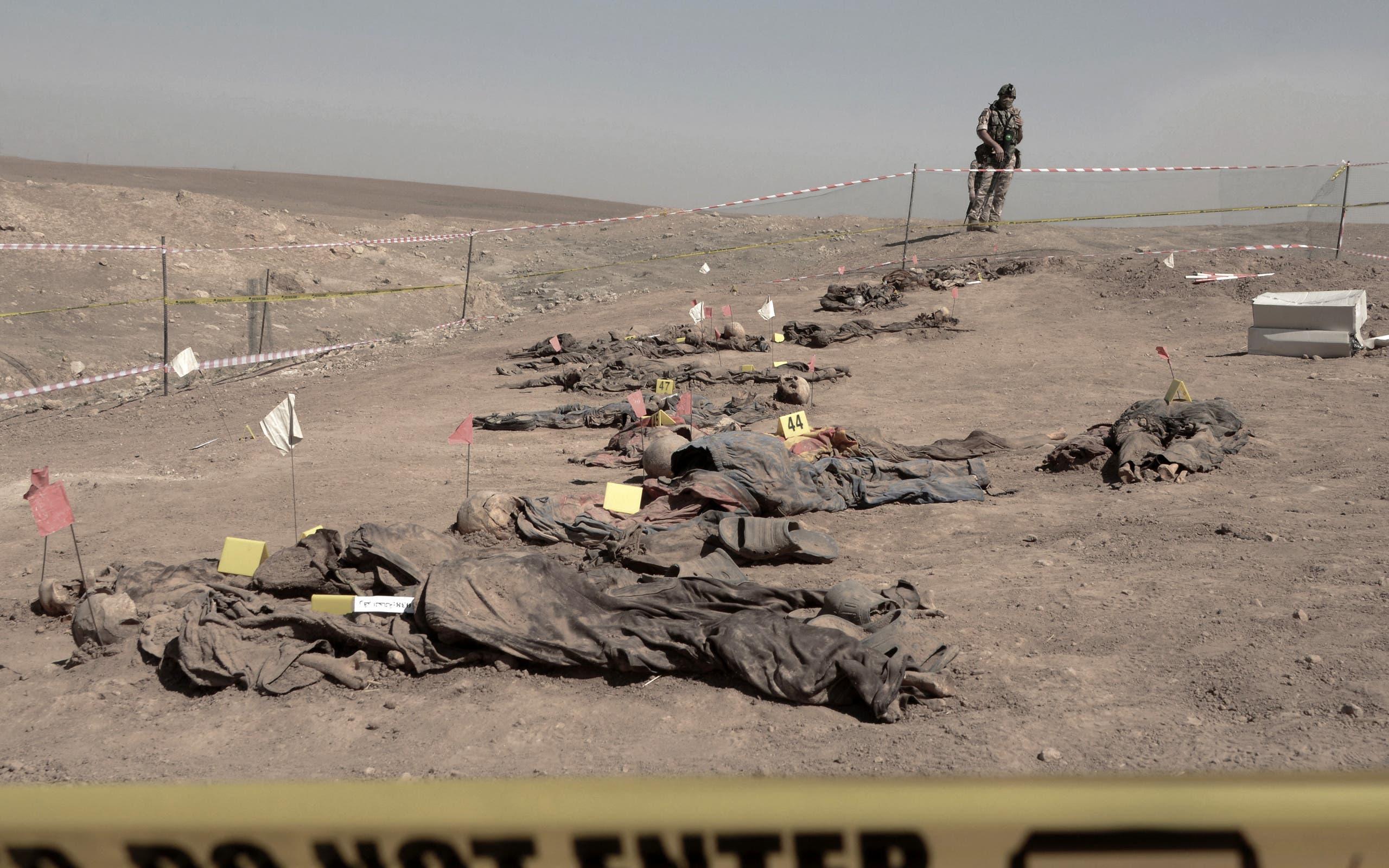 رفات تم استخراجها من المقبرة الجماعية لسجناء بادوش