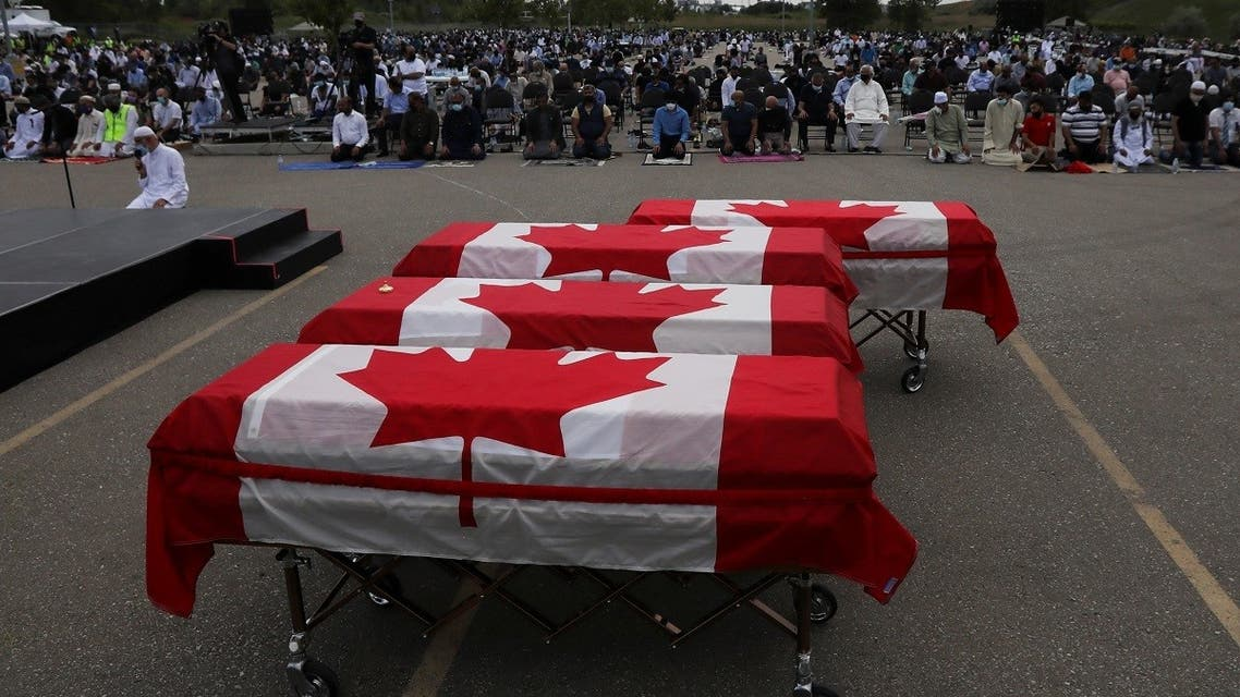 """Flag-wrapped coffins are seen outside the Islamic Centre of Southwest Ontario, during a funeral of the Afzaal family that was killed in what Canadian PM Trudeau describes as a """"terrorist attack"""", in London, Ontario, Canada June 12, 2021. (Reuters/Carlos Osorio)"""