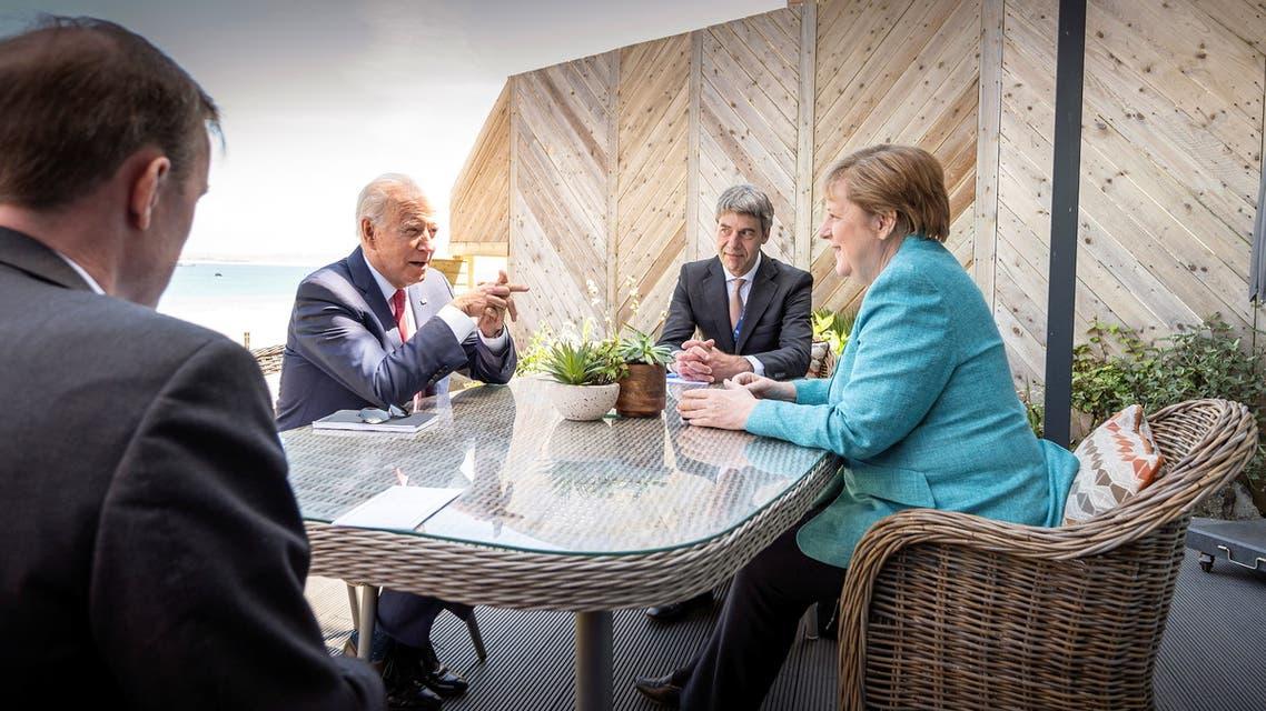U.S. President Joe Biden, German Chancellor Angela Merkel and advisors Jan Hecker (2ndR) und Jake Sullivan attend a bilateral meeting during a G7 summit in St. Ives, Cornwall, Britain, June 12, 2021. (Reuters)