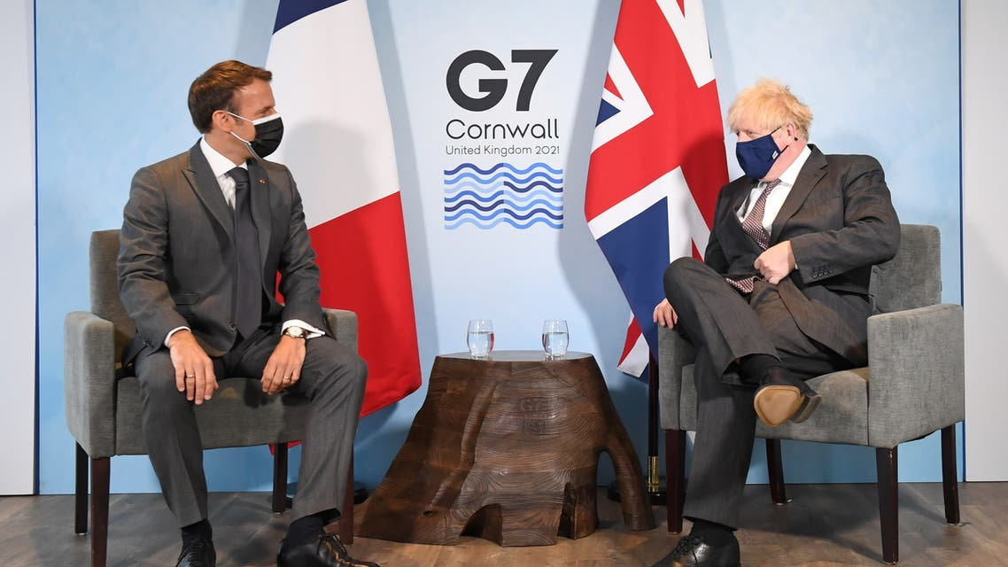 Britain's Prime Minister Boris Johnson and France's President Emmanuel Macron attend a bilateral meeting during G7 summit in Carbis Bay, Cornwall, Britain, June 12, 2021. (Reuters)