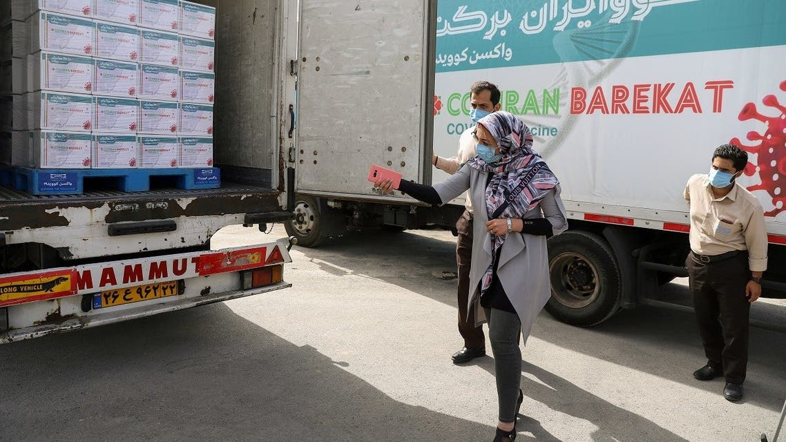 Workers are seen next to a truck loaded with Boxes of the COV Iran Barekat vaccine at the Barekat vaccine production center at the Organization of the Execution of Imam Khomeini's Order in Karaj, Iran. (Reuters)