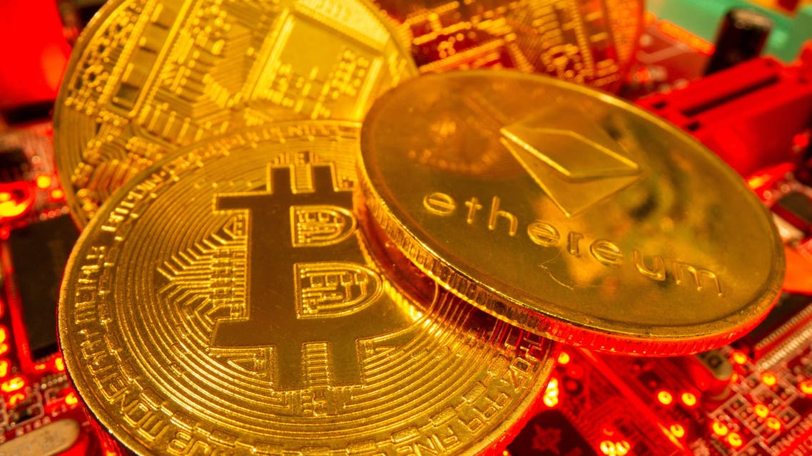 Representations of the virtual currency Bitcoin and Ethereum stand on a motherboard in this picture illustration taken May 20, 2021. (File Photo: Reuters)
