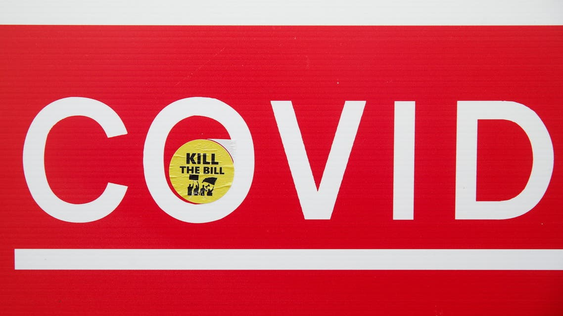 A sign with a sticker on it is seen amid the spread of the coronavirus disease (COVID-19), in Leicester, Britain, May 27, 2021. (Reuters)
