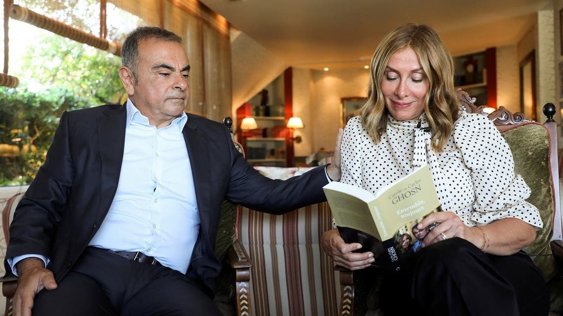 Carole Ghosn, wife of  former car executive Carlos Ghosn, holds their latest book 'Ensemble toujours' during an interview with Reuters in Beirut, Lebanon, on June 14, 2021. (Reuters)