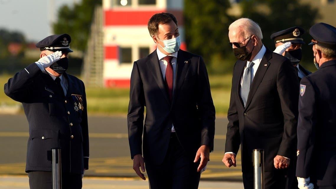 Belgium's PM Alexander De Croo welcomes US President Joe Biden as he arrives ahead of a NATO summit, at Brussels Military Airport in Melsbroek, Belgium June 13, 2021. (Didier Lebrun/Pool via Reuters)