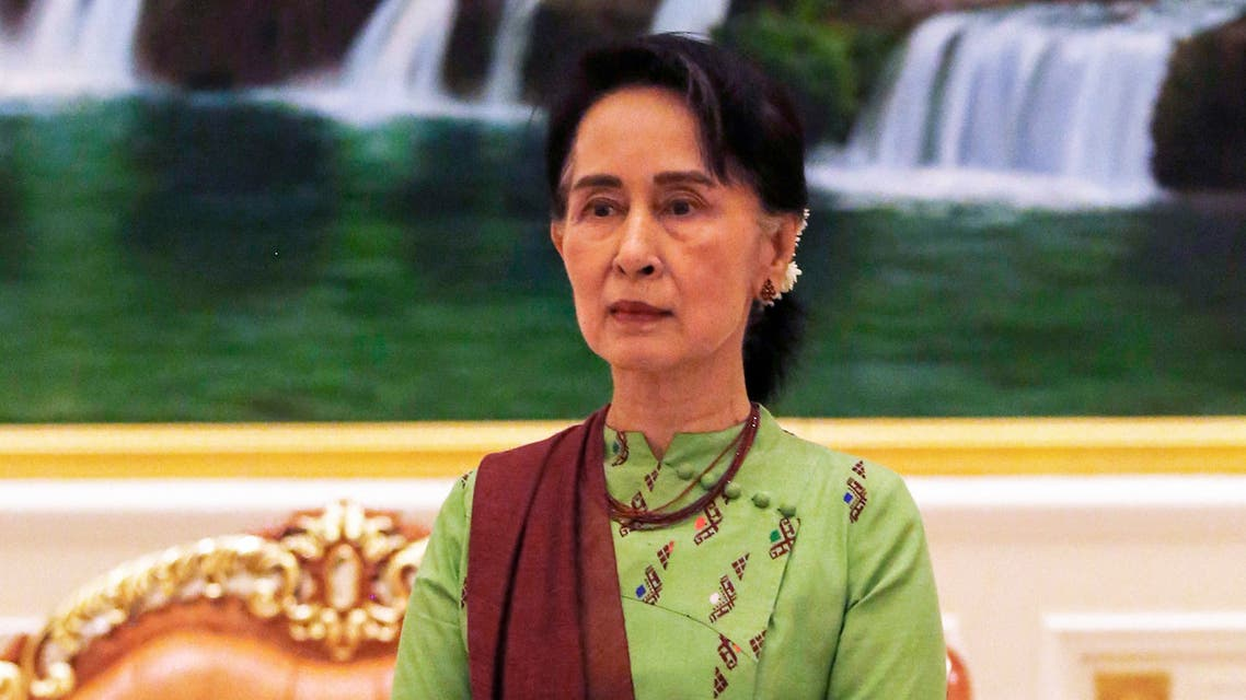 (FILES) In this file photo taken on May 22, 2018, Myanmar's State Counsellor Aung San Suu Kyi waits to greet Wang Zhengwei, vice chairperson of the Chinese People's Political Consultative Conference (CPPCC), in Naypyidaw. Ousted Myanmar leader Aung San Suu Kyi will hear the first testimony against her in a junta court on June 14, 2021, more than four months after a military coup.